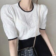 VICONE Corea del Sur Ins estilo occidental cuello redondo costura contraste fino hueco diseño de amor mangas abullonadas suéter camisa
