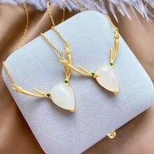 Nouveau argent incrusté de naturel Hotan blanc jade pith wapiti modèle pendentif collier doré lumière de luxe femmes charme marque bijoux
