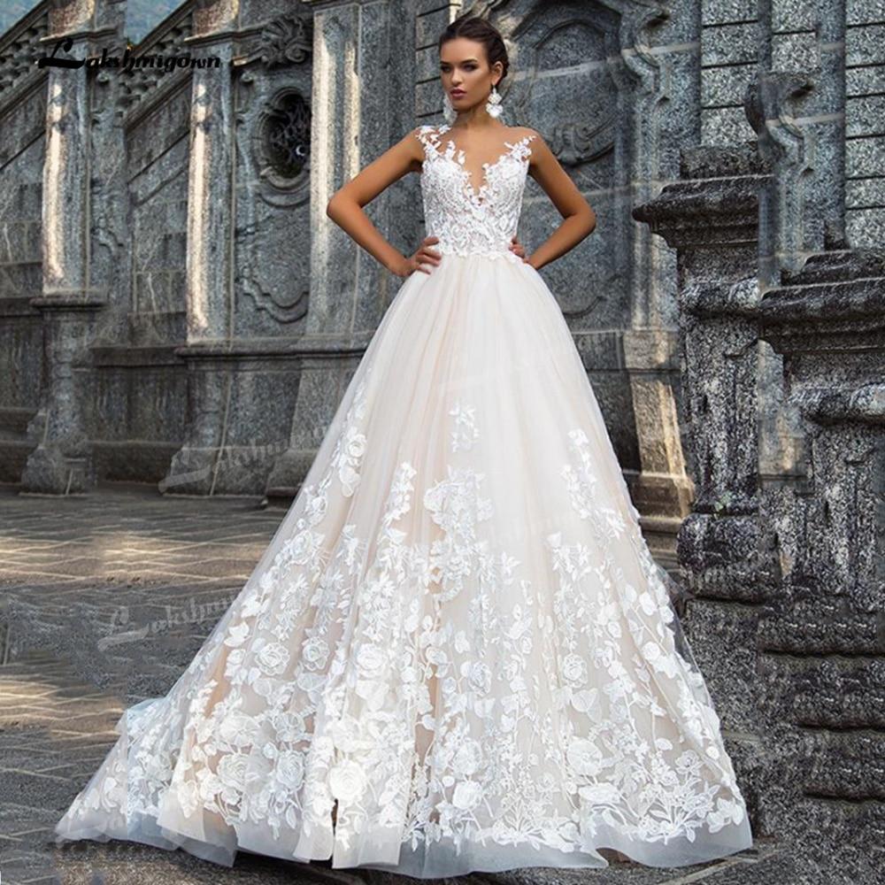Promo Gorgeous Tulle A-Line Wedding Dresses Illusion Boat Neck Low Open Back Cap Short Sleeve Chapel Train Bride Gowns Appliques Bead