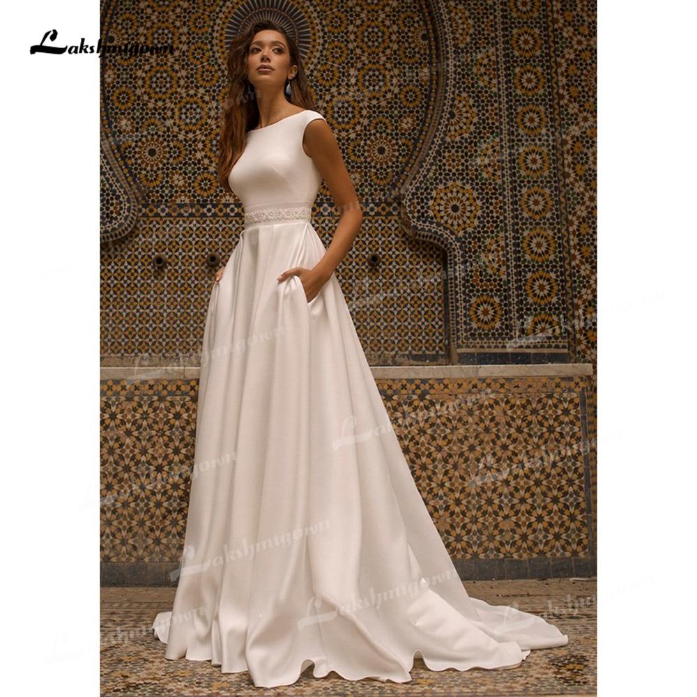 Get Elegant Soft Satin A-Line Wedding Dresses Boat Neck Cap Short Sleeve Open Back Court Train Bride Gowns Pockets Simple Pleats