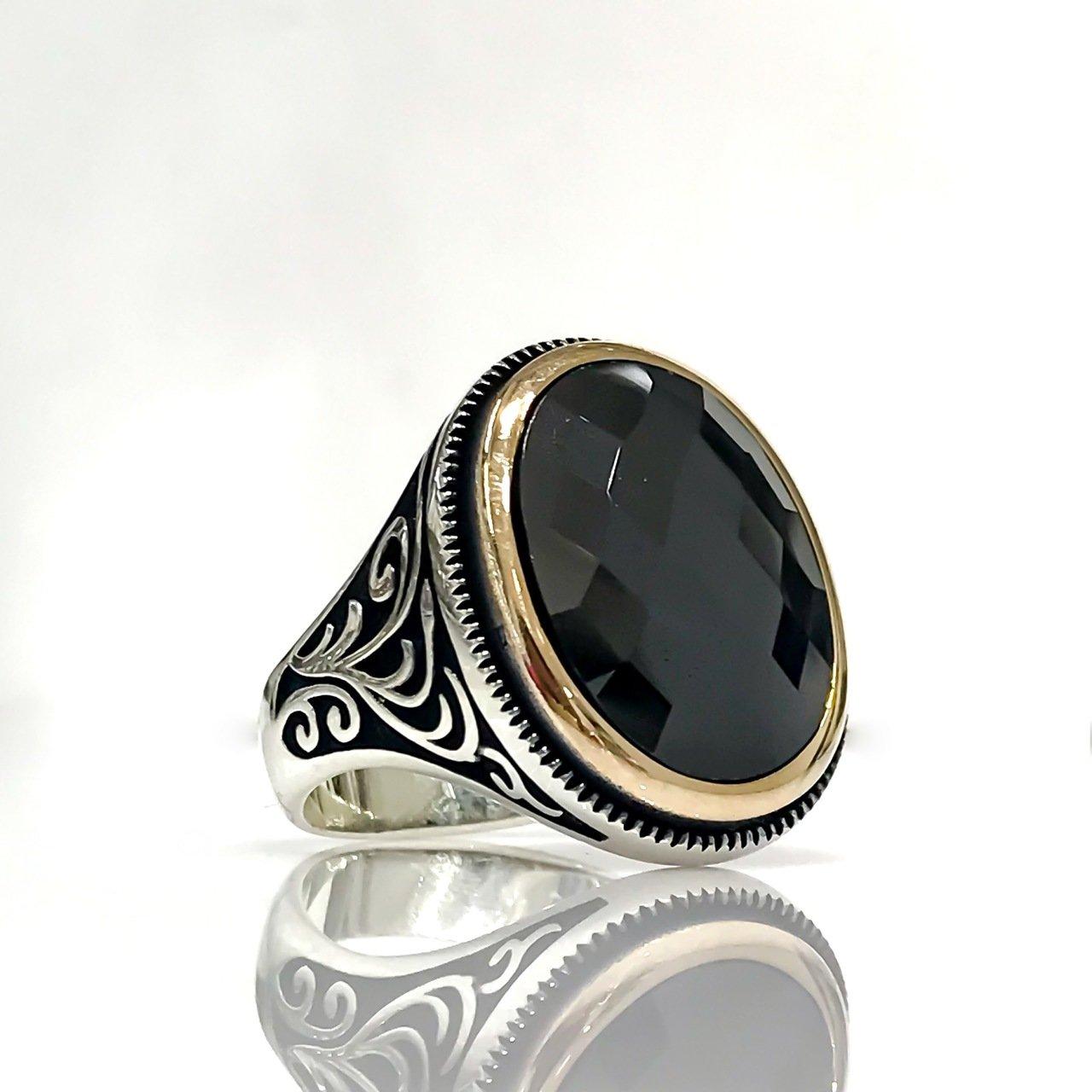 خاتم رجالي بتصميم بيضاوي من حجر العقيق الأسود