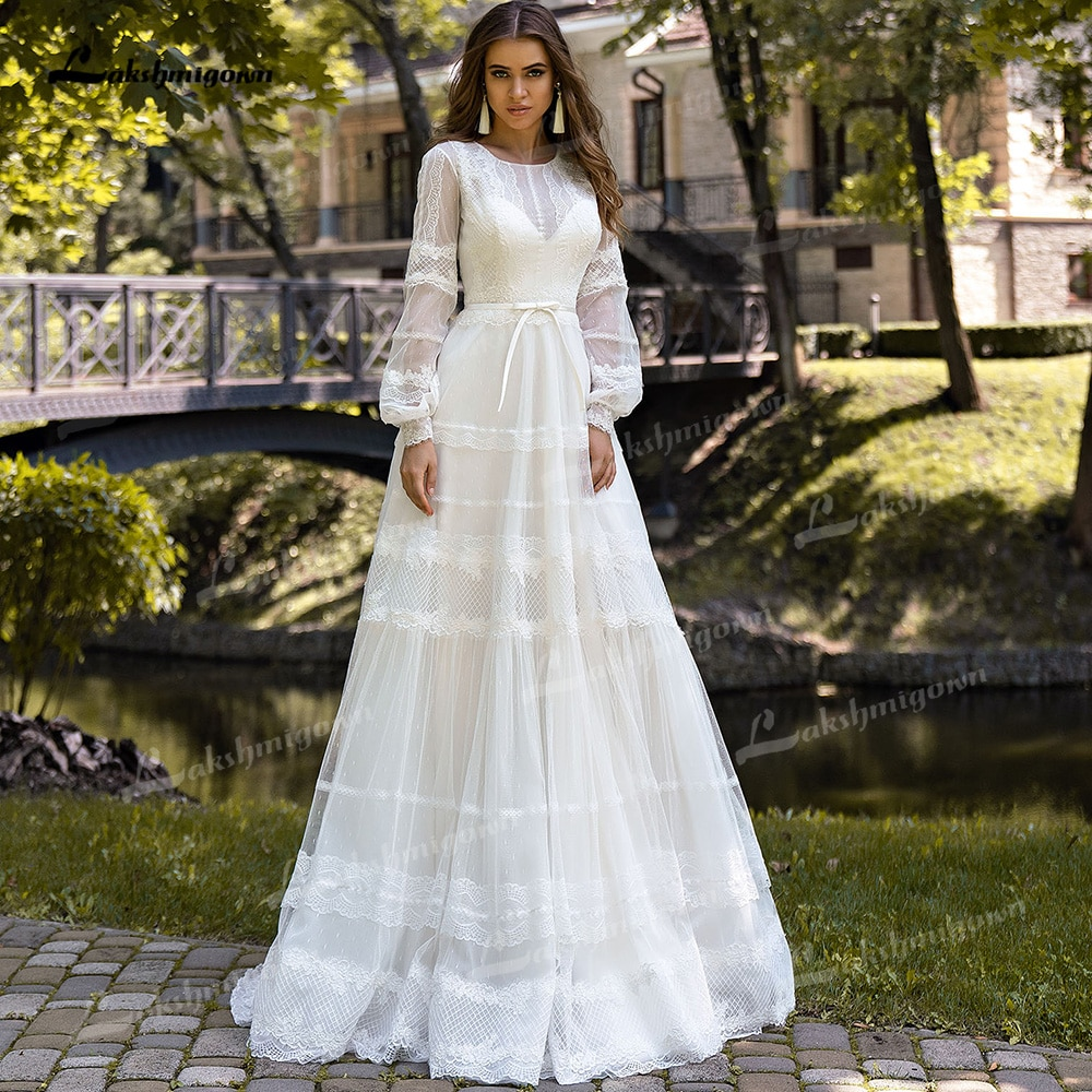 Get Elegant Tulle A-Line Wedding Dresses O-Neck Puff Long Sleeve Built-In Corset Sweep/Brush Train Bride Gown Sashes Appliques Pleat